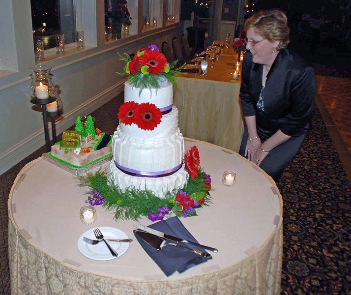 Jean admires the wedding cake.