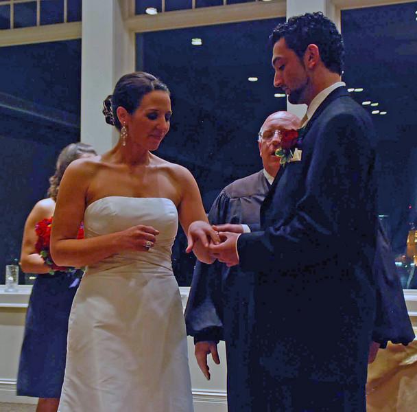 Brett places the wedding ring on Allison's finger.
