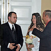 The bride and groom, Micah and Carole Vanella, arrive at their reception at the Oakwood Country Club.