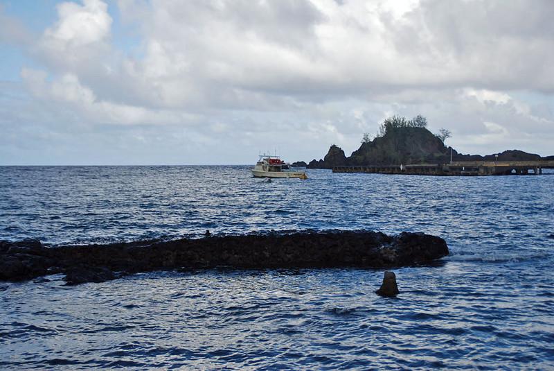 Boat leaving the Hana Bay Harbor.