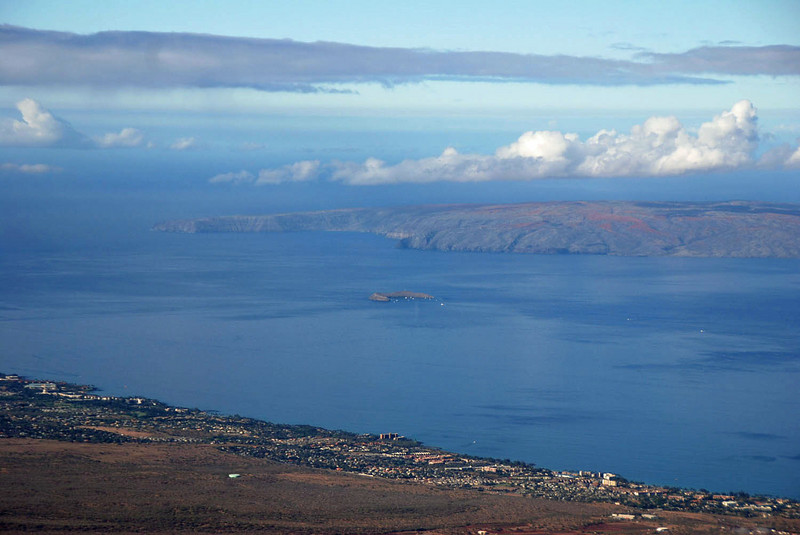 Molokini Crater and Molokai seen from the air.