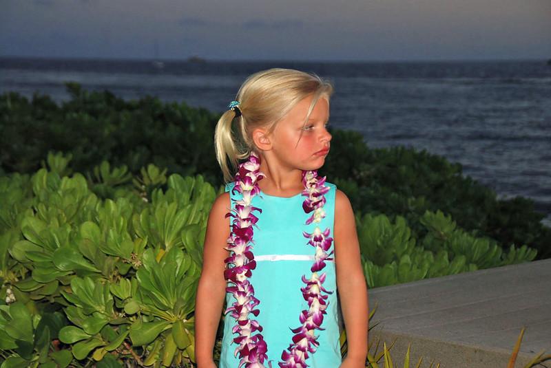 Young girl studying the hula dancers.