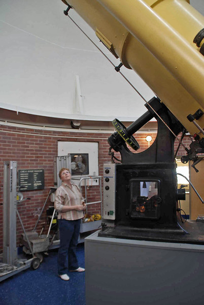 Jean looks up at the 24-inch Seyfert Telescope at Dyer Observatory.
