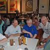 Robert Baldwin, the original owner of Pancake Pantry, enjoys a laugh with the fencing club alumni.