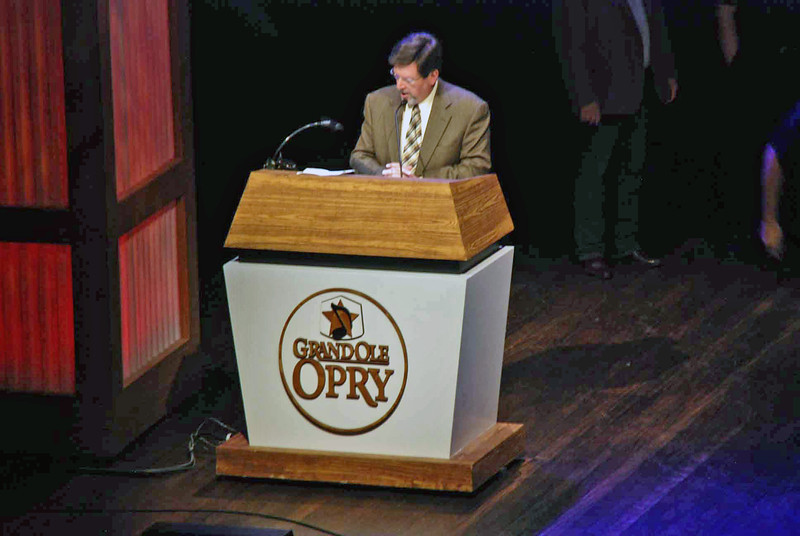 Grand Ole Opry announcer, Mike Terry, does the radio commercials in addition to introducing each of the hosts of the show.
