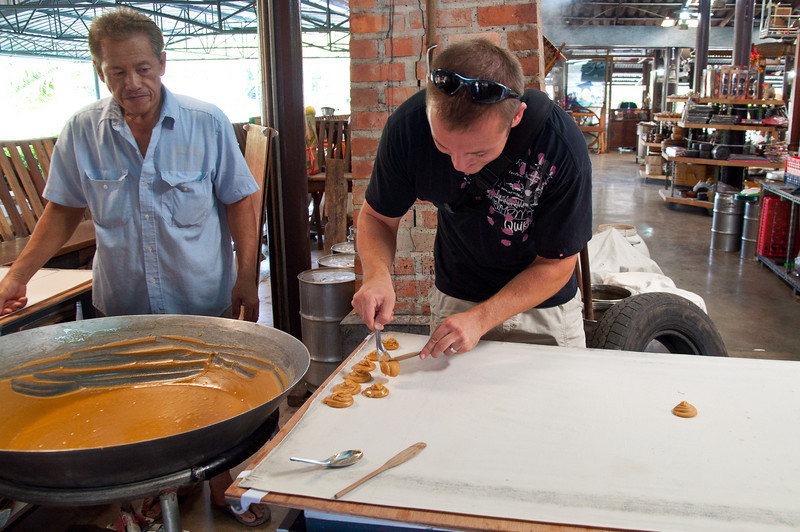 Molding the palm sugar into the shapes it's sold in.