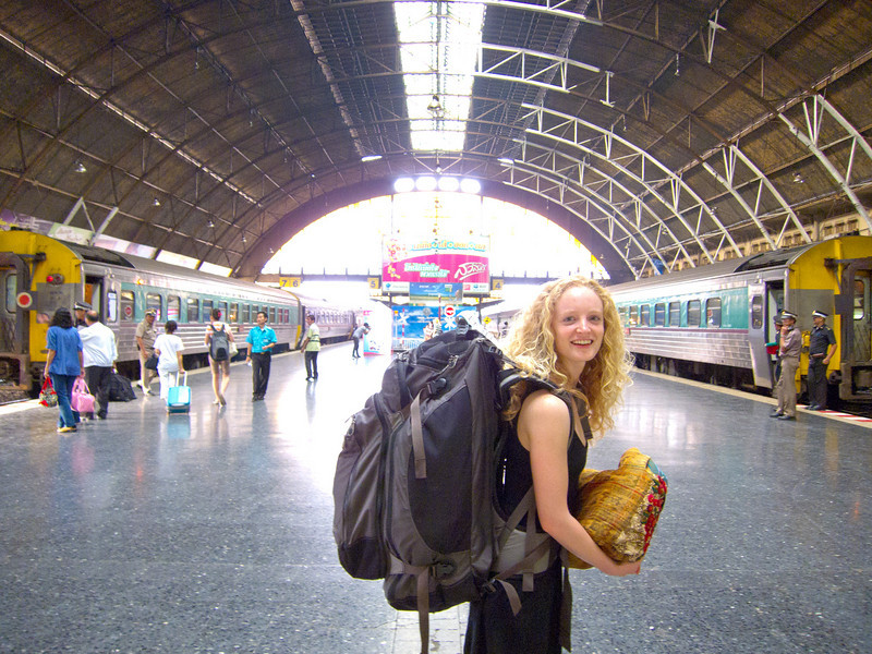 Tay in the Bangkok train station with her enormous backpack.