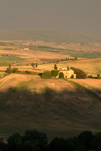 Sunset shadows encroach the Val d'Orcia as seen from Cretaiole