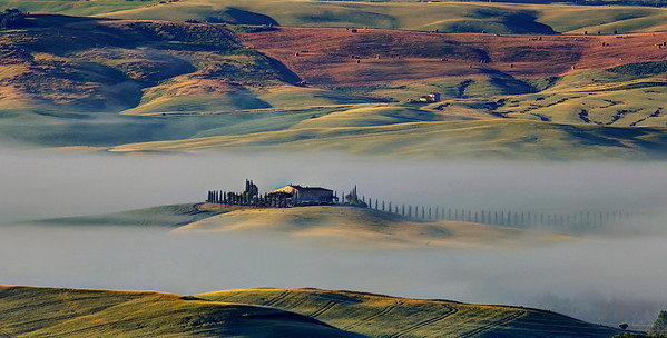 Villa outside of San Quirico d'orcia at dawn. Toscano.