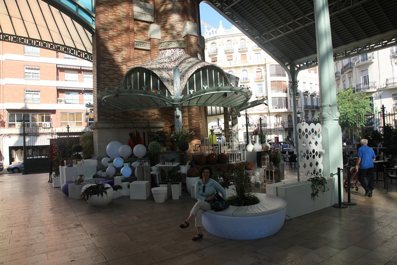Banu  sitting inside Mercado de Colon