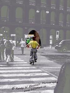 Unicyclist in front of Plaza de Toros de Valencia, Spain