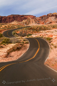Winding Road ~ This road wanders through Valley of Fire State Park in Nevada.  I liked the way it curves as it heads out into the beautiful red formations.
