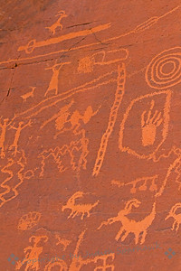 Petroglyphs on Atlatl Rock ~ Photographed in the Valley of Fire in Nevada.  There are petroglyphs in several areas of the valley.  They show people, animals and other symbols of native life.