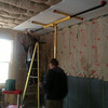 April 5 - The guys started drywalling the ceiling and upper walls, using a rented machine. It took two days.