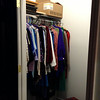 Mom has a big closet with a rod on one side. Quang will build in more storage later.