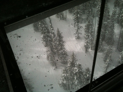 Looking down through the glass bottom Peak to Peak gondola.