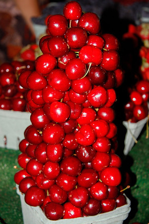 Yummy stack of cherries at the market in Granville Island.