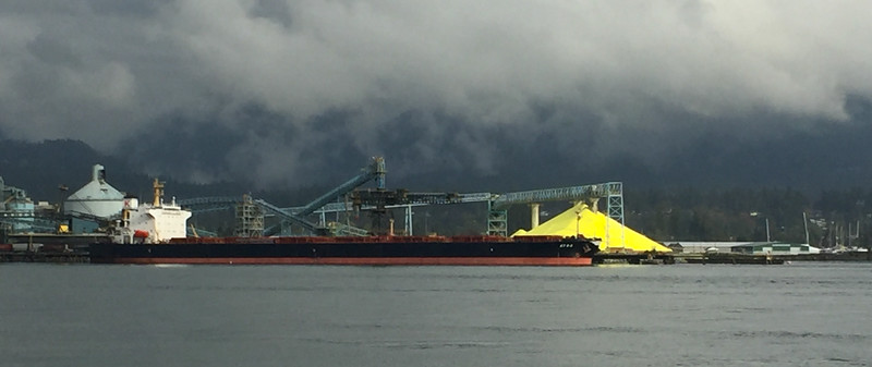 Across the harbor on a dreary morning, the giant pile of sulfur awaiting a ship to take it away certainly stood out!