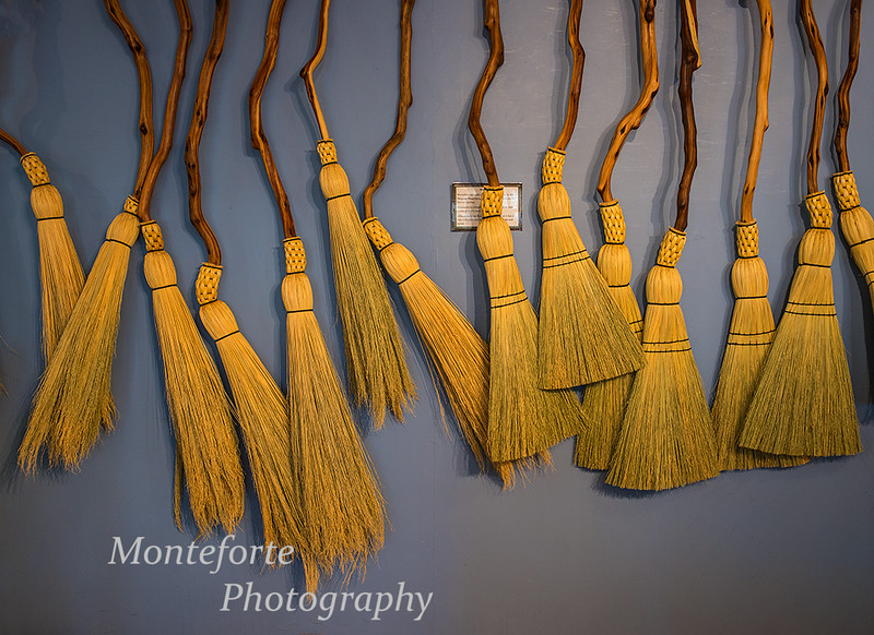 Brooms on wall at the broom compamy store on Granville Island Vancouver BC