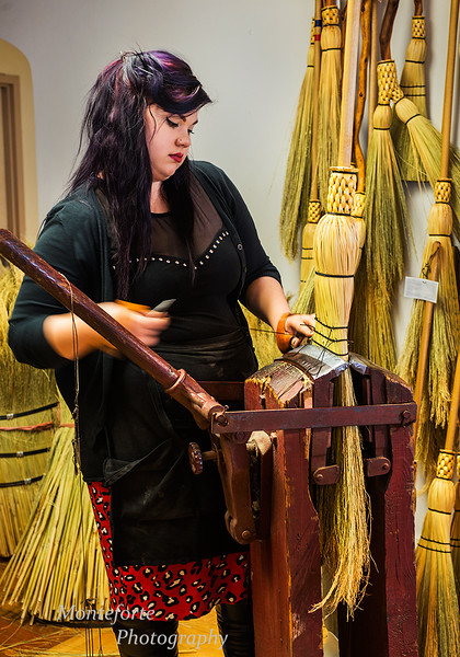 Woman making brooms in the broom store on Granville Island Vancouver BC