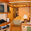 Our room.  Mini-suite has 2 twin beds, 1 sofa bed, 2 televisions (one facing bedroom and one facing sitting room).