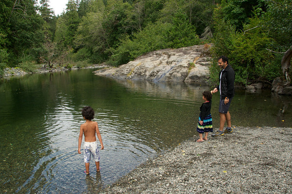 Trying to teach the kids how to skip stones on the water