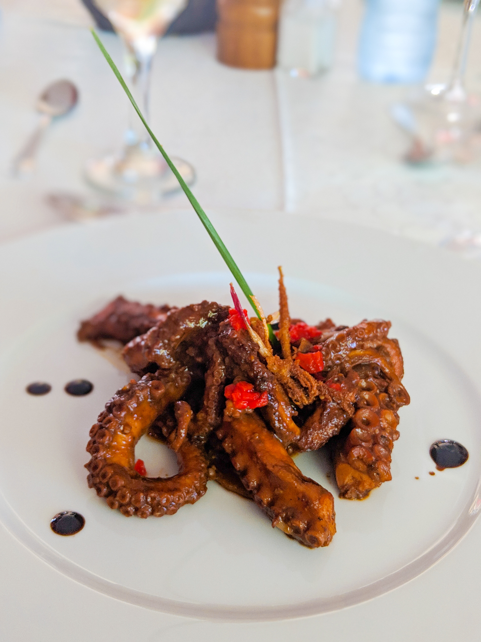 Grilled octopus on a white plate at Las Terrazas restaurant
