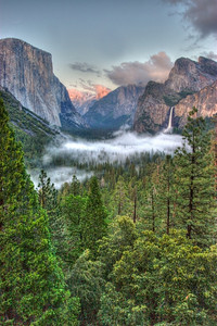 Yosemite, the same photo that every other Park tourist on the face of the Earth has in their collection. Maybe a little more mist, maybe a bit fewer clouds, but the same view.