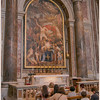 The Faithful gathering before a side alter in St. Peter's.