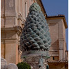 The ancient pinecone adorning a courtyard near the museum entrance.