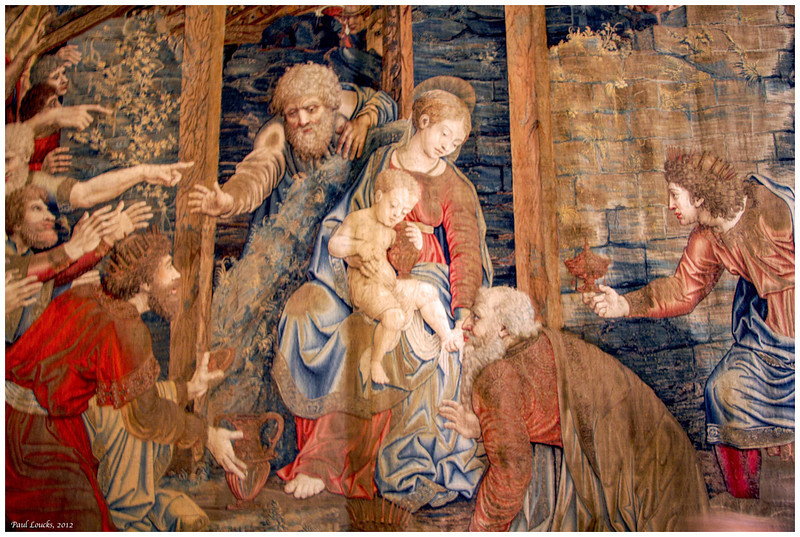 This amazing medieval tapestry conveys a visit by the Wisemen to the infant Jesus.