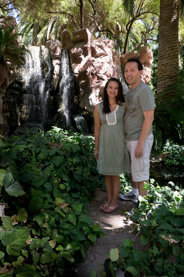 Catherine and Vu in front of a waterfall at the Flamingo habitat at the Flamingo Hotel