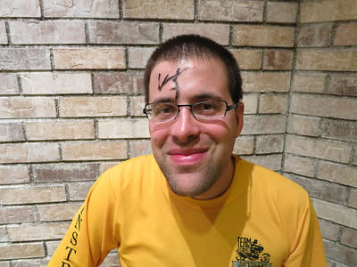 Ted's forehead, signed by Penn Jillette.