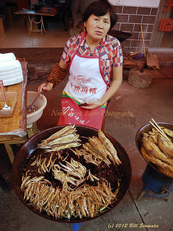Fried fish vendor in China