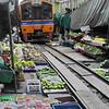 Here comes the train! Maeklong Railway Market (Talad Rom Hub): railway market near Bangkok