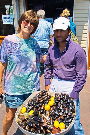 Sue poses with mussel vendor near Galata Bridge, Istanbul, Turkey