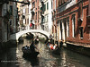 Gondolas and bridge over small canal, Venice