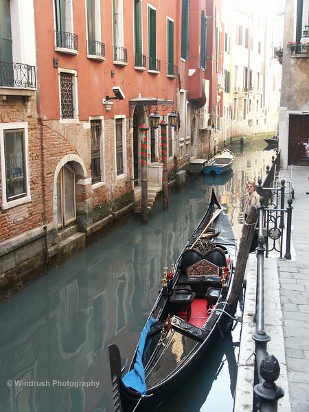 Gondola in small canal, Venice