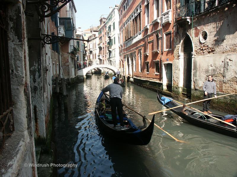 Gondolas and bridge over small canal, Venice