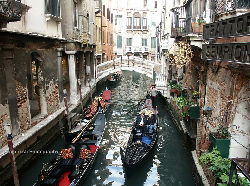 Gondolas on small side canal, Venice