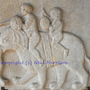 Byzantine sculpture of two children riding  on an elephant, in marble
