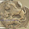 Byzantine carving of a lion attacking a bull in a marble medallion. From the Franchetti gallery in Venice.