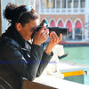 Photography in Venice: a woman photographer takes a shot of the Grand Canal from a Venitian Palace