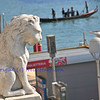 The lion, symbol of Venice, looks out over the Grand Canal, Gondolas and water taxis