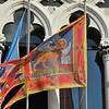 the flag of Venice flying outside an old building on the grand canal with the lion, symbol of the evangelist St Mark