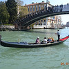 Classic Venice - a gondola moving under the Academia Bridge