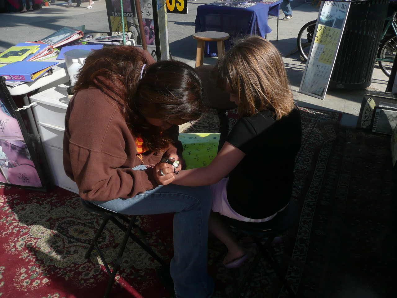 Lauren getting a Henna Tattoo.