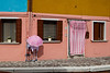 Pink umbrella and curtain in Burano, Venetian lagoon, Italy