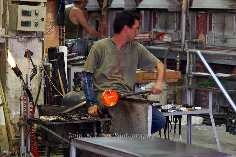 Craftsman at work in glass factory, Murano, Venetian Lagoon, Italy