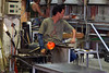 Craftsman at work in glass factory, Murano, Venetian Lagoon, Italy